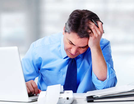 stress: Man having migraine headache. Stock Photo