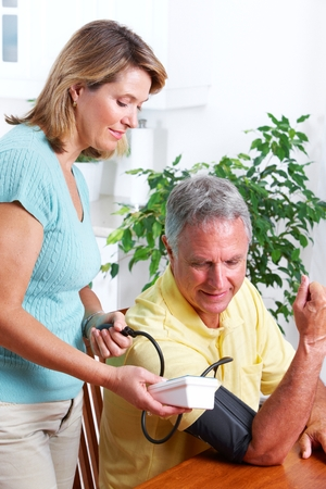 hypotension: Blood pressure measuring. Stock Photo