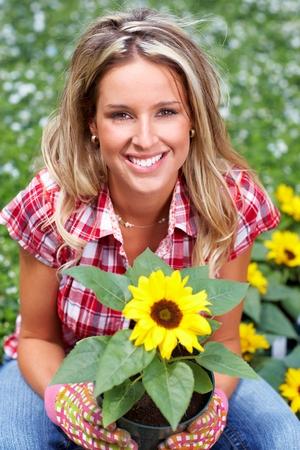 foliar: Woman planting sunflower.