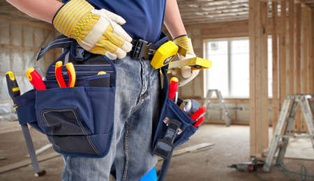 building tool: Worker with construction tools.