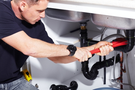 residential homes: Plumber at work Stock Photo