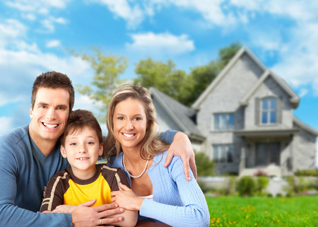ownerships: Family near new house.