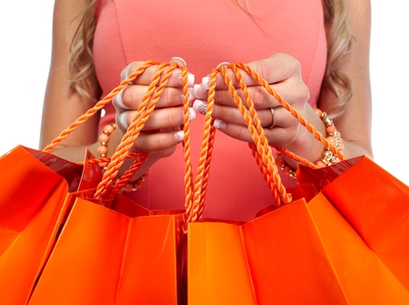 sell out: Woman hands with shopping bags.
