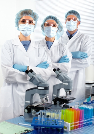 immunology: Group of medical doctors in laboratory.