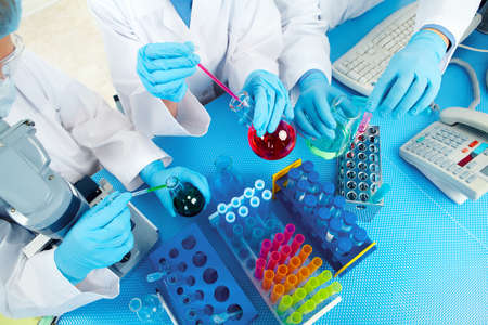 clinical laboratory: Group of medical doctors in laboratory.