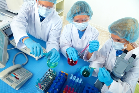 research worker: Group of medical doctors in laboratory.