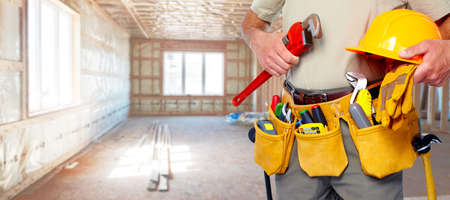 house renovation: Builder handyman with construction tools.