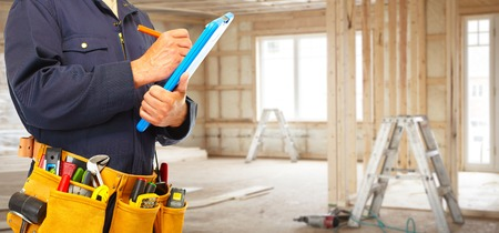 residential homes: Builder handyman with construction tools.
