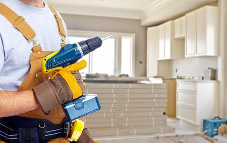 carpenter: Builder bricoleur avec des outils de construction. Banque d'images