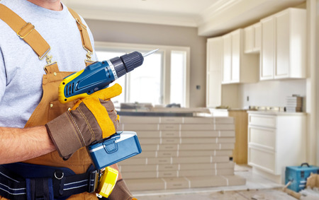 Builder handyman with construction tools. photo