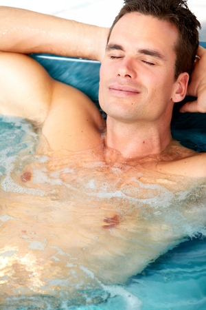 tub: Man relaxing in bathup.