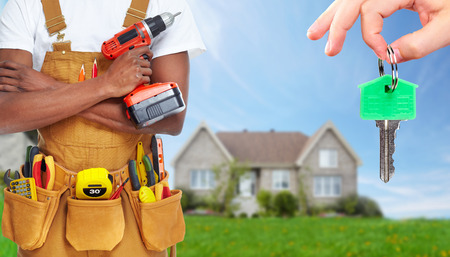 plumber tools: Builder handyman with construction tools.