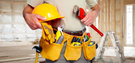 toolbelt: Builder handyman with construction tools.