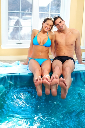 love hot body: Young couple relaxing in pool Stock Photo