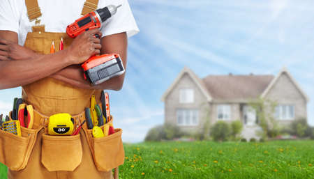 home builder: Builder handyman with construction tools.