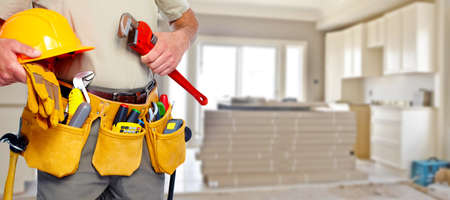residential home: Builder handyman with construction tools.
