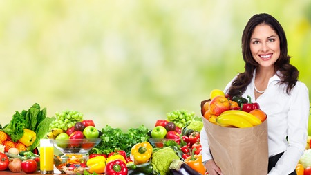 Woman with Vegetables over green background. photo