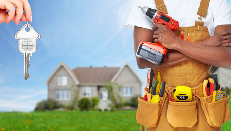 residential construction: Builder handyman with construction tools.