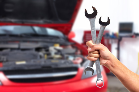 wrench: Hand of car mechanic with wrench.