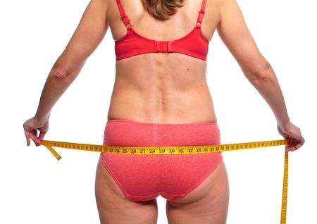 loose skin: Woman measuring body fat.