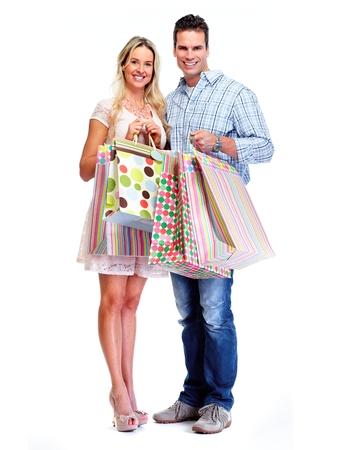 jovenes enamorados: Pareja feliz con bolsas de la compra. Foto de archivo