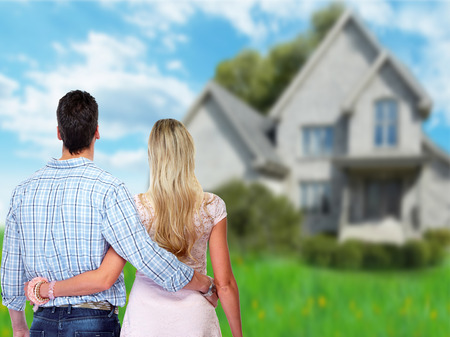 new home: Young couple looking new home.