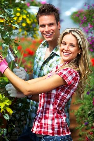foliar: Gardening people. Stock Photo