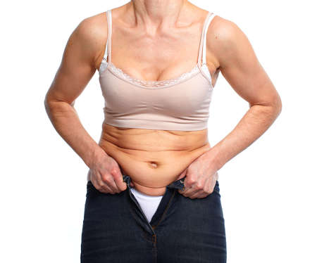 belly fat: Woman fat belly. Diet and weight loss concept. Stock Photo