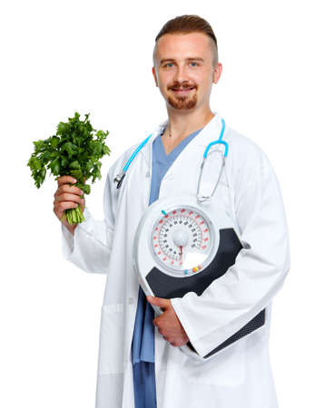 weigher: Medical doctor nutritionist with body scales and parsley. Weight loss.