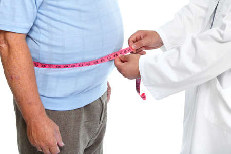 lose weight: Doctor measuring obese man waist body fat. Obesity and weight loss.