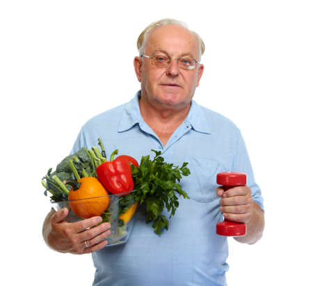 old people: Elderly man with vegetables and dumbbell isolated over white background. Stock Photo