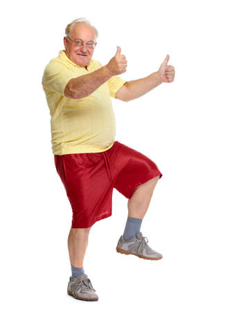cardio fitness: Happy cheerful elderly man dancing and jumping isolated white background. Stock Photo
