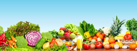 vege: Fresh organic vegetables over blue background. Healthy diet.