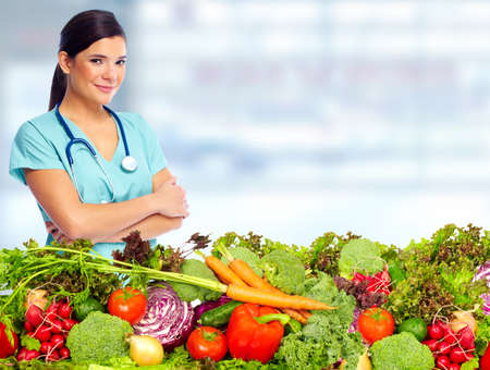 dietitian: Doctor woman with vegetables. Healthy diet and nutrition. Stock Photo