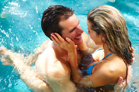 couple relaxing: Young couple relaxing in hot tub. Summer vacation.