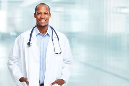 african business people: Medical physician doctor man over hospital background.