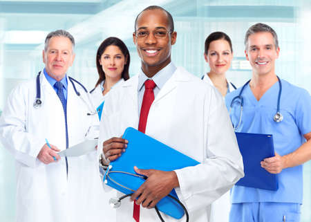 specialists: Medical physician doctor man and group of business people.