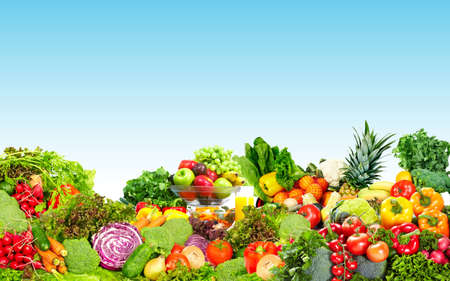 fiber food: Fresh organic vegetables over blue background. Healthy diet.