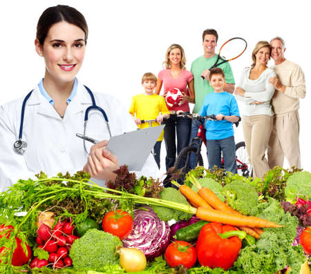 vitality: Doctor with vegetables and family. Healthy diet and nutrition.