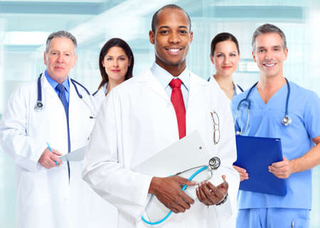 smiling doctor woman: Medical physician doctor man and group of business people.