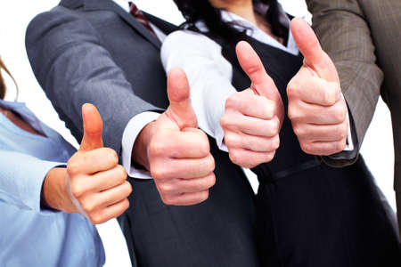 employment: Hands of happy business people with thumbs. Stock Photo