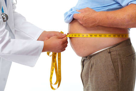 stomach: Doctor measuring obese man waist body fat. Obesity and weight loss.