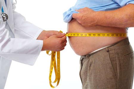 obeso: Medición del doctor obeso gordo cuerpo de la cintura. La obesidad y la pérdida de peso. Foto de archivo