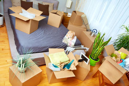 messy room: Moving boxes in new house. Real estate concept.