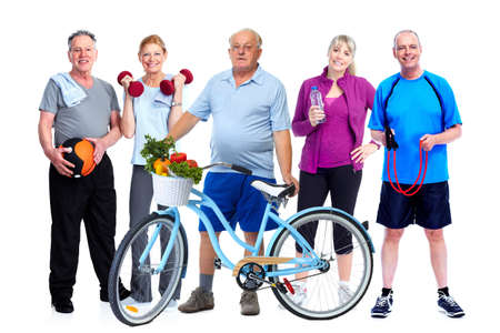 elderly: Group of elderly fitness people with bicycle isolated white background. Stock Photo