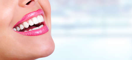 great: Laughing woman mouth with great teeth over blue background. Stock Photo