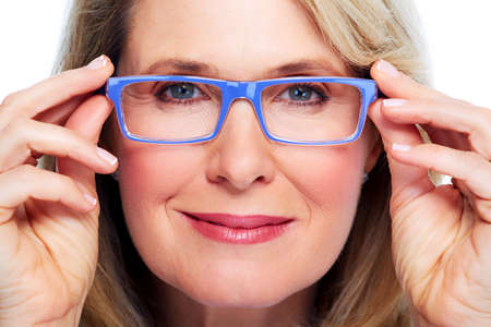 shortsightedness: Beautiful elderly lady wearing eyeglasses close-up. Stock Photo