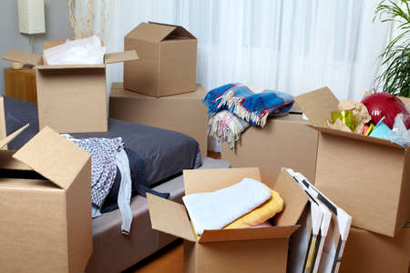 box: Moving boxes in new apartment. Real estate concept. Stock Photo