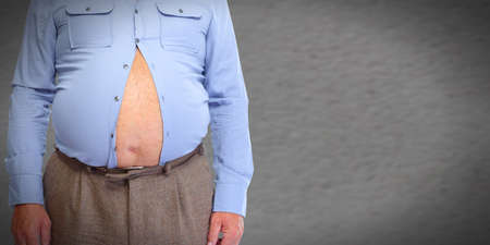 bloating: Obese man abdomen. Obesity and weight loss. Stock Photo