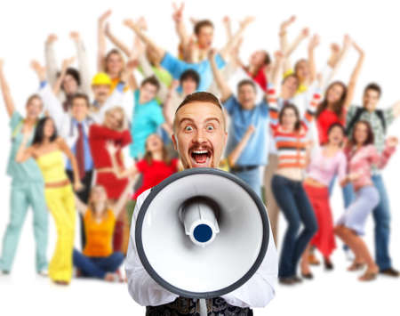 speaking: Young man talking in loud-hailer and group of happy people. Stock Photo